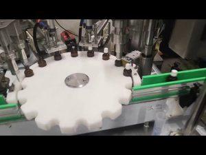 mała maszyna do napełniania butelek z płynem